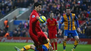 Luis Suarez of Liverpool appears to control the ball with his hand during an FA Cup against Mansfield Town