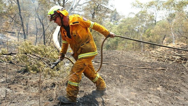 ACT Rural Fire Service members 'mop-up' spot fires at Sandhills in Bungendore, Australia.