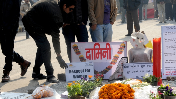 Indian activists stand near a memorial to a rape victim during a protest in New Delhi