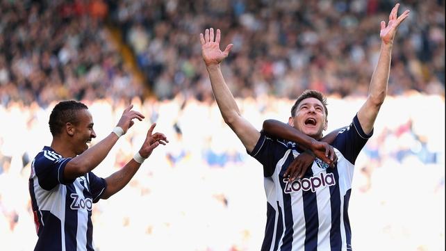 Zoltan Gera (R) celebrates a goal against QPR earlier in the season