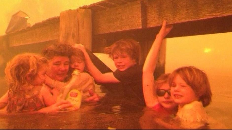 An Australian family takes shelter in the sea as wildfires rage through Tasmania