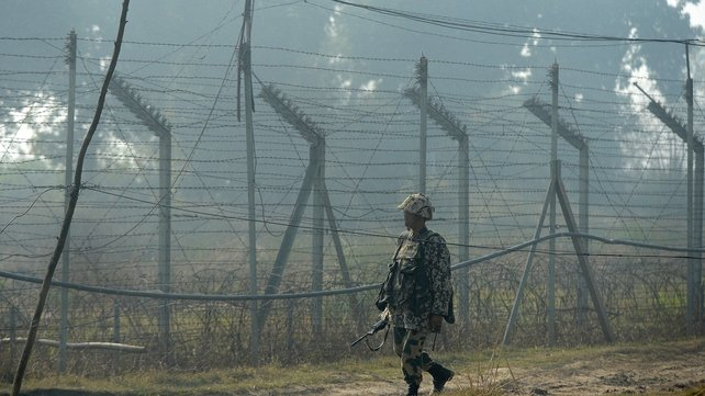 An Indian soldier patrols the border with Pakistan