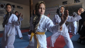 Afghan girls practise Taekwondo moves during a martial arts class in Herat