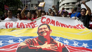 Supporters of Venezuelan President Hugo Chavez gather outside Miraflores presidential palace, during an event in homage of the President