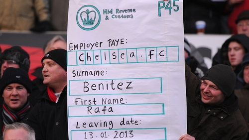 Chelsea fans with a mock P45 for manager Rafael Benitez