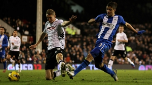 Franco Di Santo gets his shot away despite the attention of Brede Hangeland