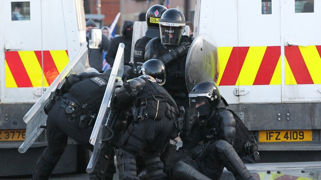 PSNI officers attend an injured colleague