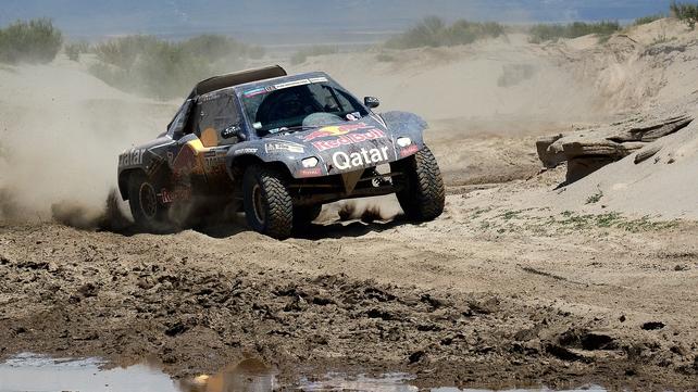 Nasser Al-Attiyah has closed the gap on Dakar Rally leader Stephane Peterhansel