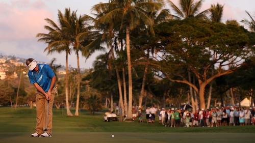 Russell Henley putting on the 18th hole at the Waialae Country Club in Honolulu