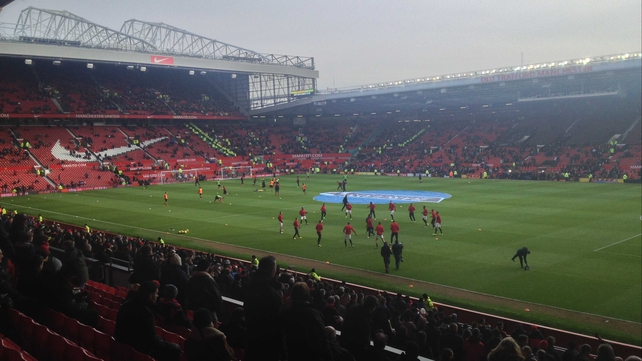 The two teams warming up on the pitch