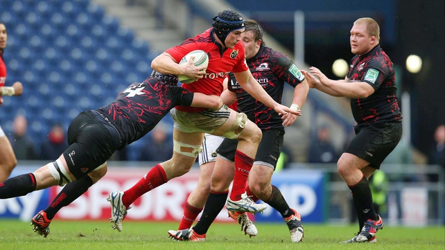 Munster's Tommy O'Donnell is tackled by Edinburgh's Grant Gilchrist