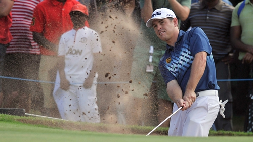 Louis Oosthuizen takes a shot out of the bunker on the 16th hole