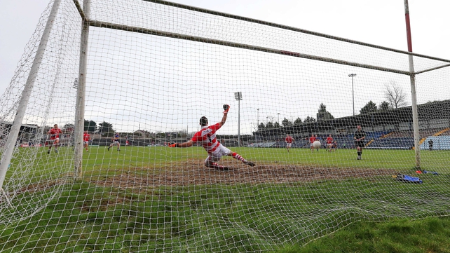 Tipperary's Barry Grogan scores from the penalty spot against Cork