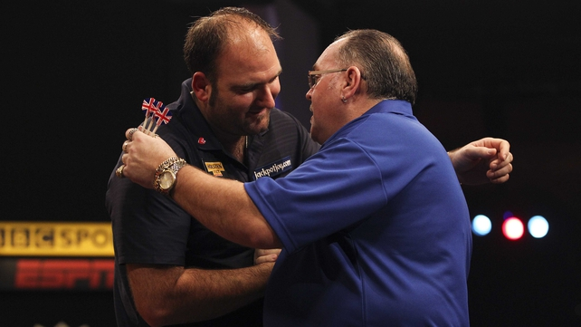 Scott Waites (left) embraces Tony O'Shea after winning the final of the BDO Lakeside World Professional Darts Championships at the Lakeside Country Club
