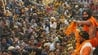 Indian yoga guru Baba Ramdev throws garlands to devotees during a procession ahead of Kumbh Mela