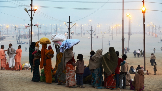 A family arrives for the Kumbh Mela festival