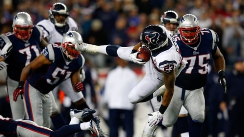 Arian Foster gets knocked off his feet as his team the Houston Texans were eliminated from the NFL play-offs