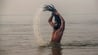 A naga sadhu bathes in the waters of the holy Ganges