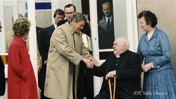 President Reagan shakes hands with Father John Murphy