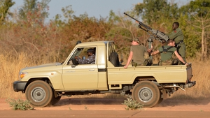 French soldiers sit aboard a Malian military armed car