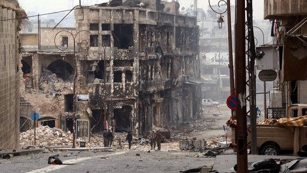 Syrian government troops take position in a heavily damaged area in the old city of Aleppo in northern Syria