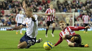 Jack Colback (R) concedes a penalty by tackling Bolton Wanderers' Darren Pratley
