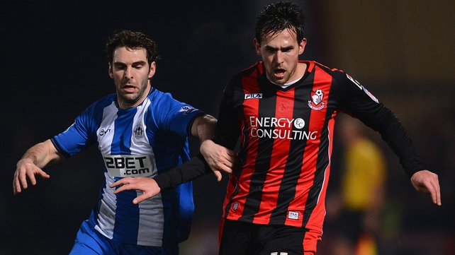 Charlie Daniels of Bournemouth and Mauro Boselli of Wigan