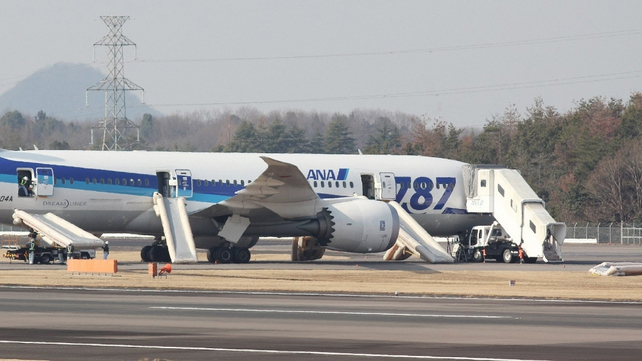 A Boeing 787 Dreamliner operated by All Nippon Airways sits on the tarmac after an emergency landing at Takamatsu Airport