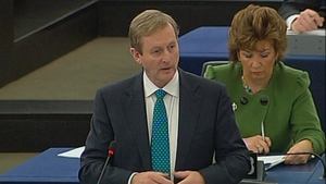 Enda Kenny said the people of Ireland still laboured under the weight of bank-related debt