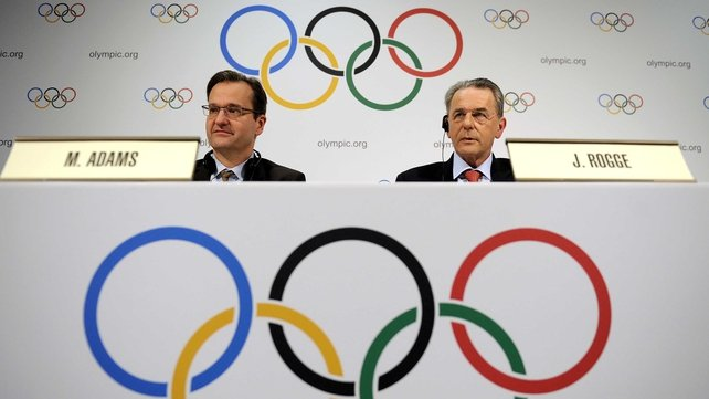 International Olympic Committee director of communications Mark Adams (left), pictured with IOC president Jacques Rogge (right)