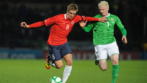 Northern Ireland's Ryan McGivern (right) vies with Norway's Markus Henriksen (left) during an international friendly match
