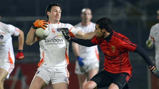 Armagh's Stefan Forker tussles with Down's Gerard McAnulty