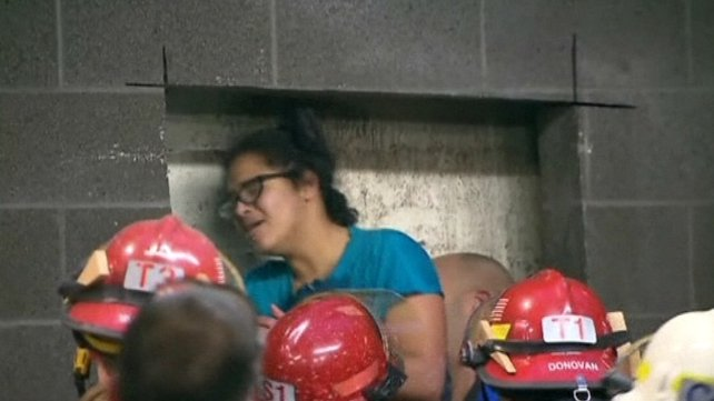 The woman was freed after four hours stuck between the walls