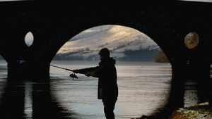 An angler casts during the opening of the salmon fishing season on the River Tay in Kenmore, Scotland