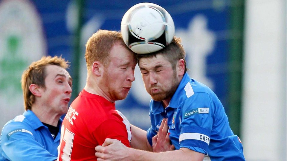 Two heads better than one? Cliftonville's Liam Boyce with Ballinamallard's Mark Stafford
