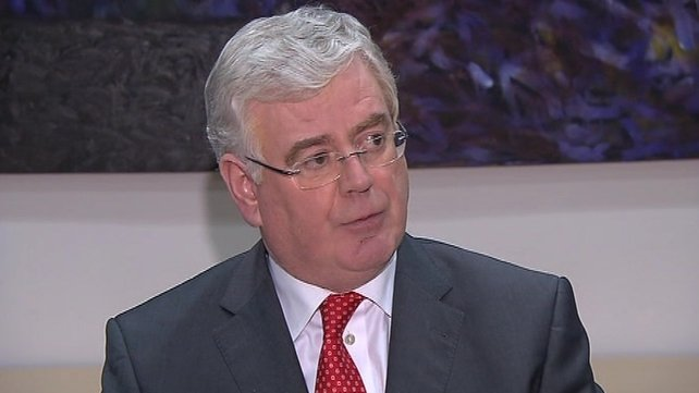 Eamon Gilmore praised the work of community leaders in Northern Ireland