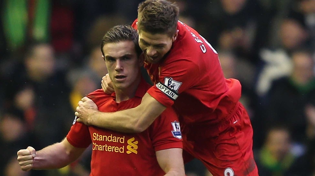 Jordan Henderson of Liverpool celebrates scoring the opening goal with team-mate Steven Gerrard
