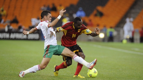 Angola's Geraldo is challenged by lunging Morocco star Nordin Amrabat