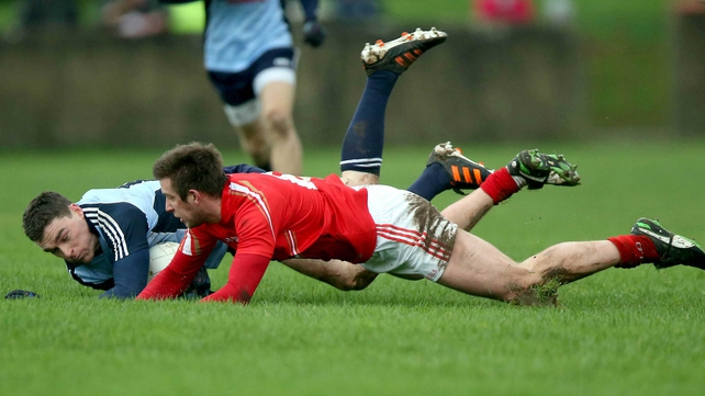 Paddy Andrews of Dublin and Louth's Liam Shevlin scramble for possession