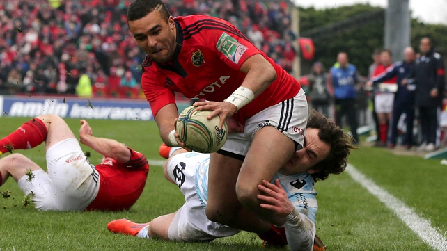 Simon Zebo scored a hat-trick of tries as Munster booked their place in the Heineken Cup quarter-final