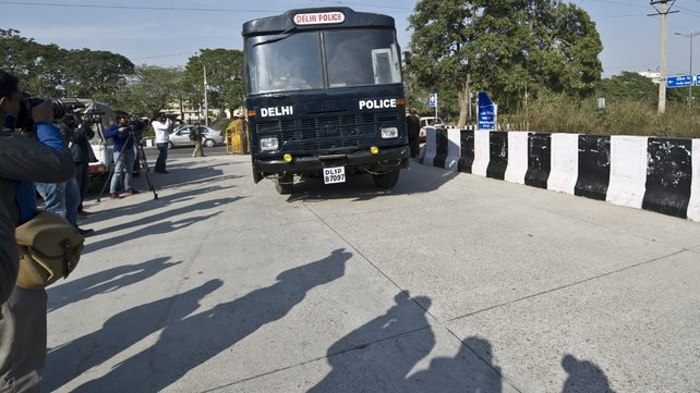 A prisoner transport vehicle, believed to be ferrying the accused, enters the district court in New Delhi