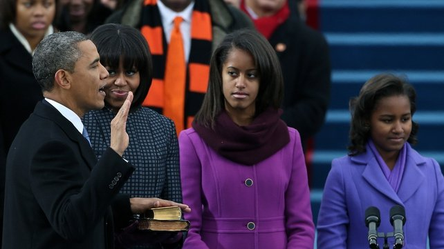 Mr Obama's wife and children look on as he takes his oath