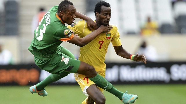 Zambia's Stoppila Sunzu gets to grips with Ethiopia's Said Ahmed