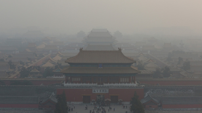 The Forbidden City in Beijing is shrouded in smog as pollution levels reach record highs