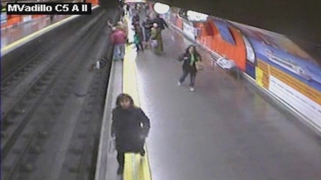 Passengers take action as woman lies unconscious on rail track