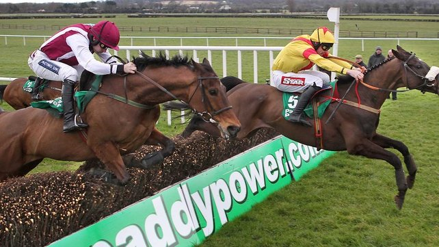 Ruby Walsh on Seabass (left) clears the last alongside Davy Russell on Zaarito