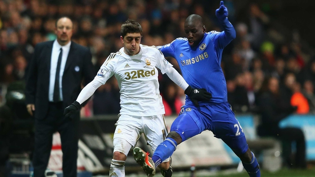 Pablo Hernandez of Swansea City is challenged by Demba Ba of Chelsea