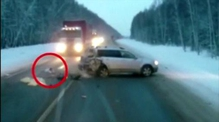 Baby snatched to safety after Russian car crash