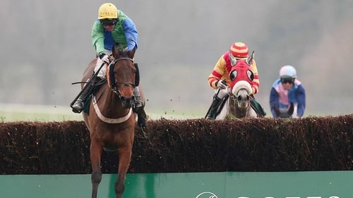 Jadanli and Andrew Lynch jump the last en route to landing the spoils
