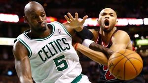 Kevin Garnett of the Boston Celtics appears to have stood on Chicago Bulls' Taj Gibson's toe at the Garden in Boston